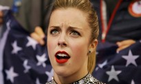 "Ashley Wagner of the United States reacts in the ""kiss and cry"" area during the Team Ladies Short Program at the Sochi 2014 Winter Olympics"