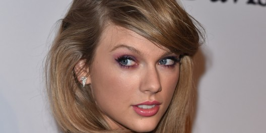 Taylor Swift arrives at the 2015 Clive Davis Pre-Grammy Gala at the Beverly Hilton Hotel on Saturday, Feb. 7, 2015, in Beverly Hills, Calif. (Photo by John Shearer/Invision/AP)